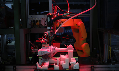 A robot assembles a power tool in a manufacturing facility in Virginia Beach, VA.